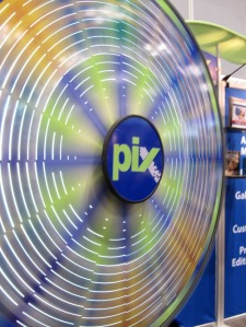 At the AdoramaPix booth you could spin the Wheel of Fortune and win a prize. I won a coupon for an 8 x 10 aluminyzed print!