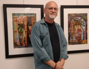 George Garbeck with two of his photographs